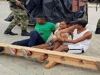 Colômbia: cidadãos que saem de casa são presos pelos pés. 33002.jpeg