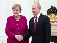 Putin e Merkel abordam temas internacionais cruciais no Kremlin. 32464.jpeg