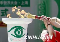Mulher chinesa de 103 anos quer ser portadora da tocha olímpica