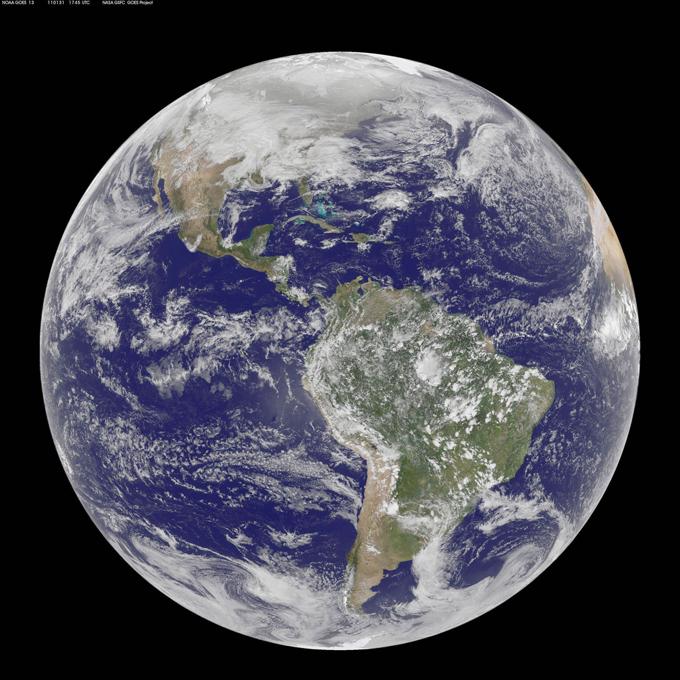 A Terra e o Sol a  partir da NASA NASA apresenta os fotos increveis do nosso planeta e do Sol. Splash/All Over